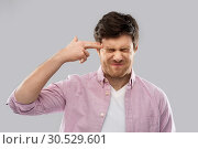 Купить «man making headshot by finger gun gesture», фото № 30529601, снято 3 февраля 2019 г. (c) Syda Productions / Фотобанк Лори