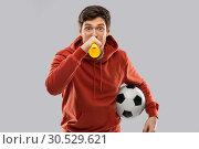 Купить «football fan with soccer ball blowing horn», фото № 30529621, снято 3 февраля 2019 г. (c) Syda Productions / Фотобанк Лори
