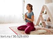 Купить «woman meditating in lotus pose at yoga studio», фото № 30529693, снято 21 июня 2018 г. (c) Syda Productions / Фотобанк Лори