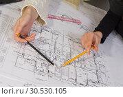 Купить «Designing the house», фото № 30530105, снято 13 марта 2010 г. (c) Tryapitsyn Sergiy / Фотобанк Лори