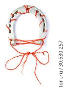 Horseshoe with red thread. Стоковое фото, фотограф Tryapitsyn Sergiy / Фотобанк Лори