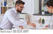 Купить «employer having interview with employee at office», видеоролик № 30531097, снято 29 марта 2019 г. (c) Syda Productions / Фотобанк Лори