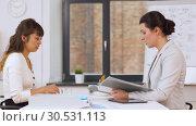 Купить «employer having interview with employee at office», видеоролик № 30531113, снято 29 марта 2019 г. (c) Syda Productions / Фотобанк Лори