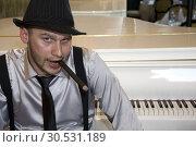 Купить «Pianist and great piano», фото № 30531189, снято 4 июня 2010 г. (c) Tryapitsyn Sergiy / Фотобанк Лори