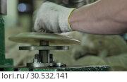 Worker In Gloves Forms Small Parts Under Press. Стоковое видео, видеограф Pavel Biryukov / Фотобанк Лори