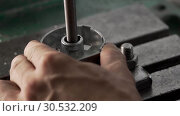 Купить «Hands Are Drilling Details Using Drilling Machine», видеоролик № 30532209, снято 21 сентября 2018 г. (c) Pavel Biryukov / Фотобанк Лори