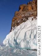 Купить «Rocks covered with ice on lake Baikal. South-Eastern Siberia, Russia», фото № 30532213, снято 16 марта 2019 г. (c) Наталья Волкова / Фотобанк Лори