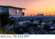 Купить «View of Downtown skyline at golden hour, Los Angeles, California, United States of America, North America», фото № 30532897, снято 27 мая 2018 г. (c) age Fotostock / Фотобанк Лори