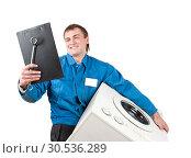 Купить «Repairman servicing washing machine», фото № 30536289, снято 3 февраля 2011 г. (c) Tryapitsyn Sergiy / Фотобанк Лори