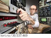 Scientist at vintage laboratory. Стоковое фото, фотограф Tryapitsyn Sergiy / Фотобанк Лори