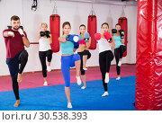 Купить «women are boxing and doing kick with coach», фото № 30538393, снято 8 октября 2017 г. (c) Яков Филимонов / Фотобанк Лори