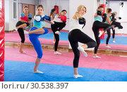 Купить «Group of adult female are doing kick in gym», фото № 30538397, снято 8 октября 2017 г. (c) Яков Филимонов / Фотобанк Лори