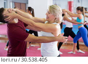 Купить «Woman is training self-defence fighter in pair with trainer», фото № 30538405, снято 8 октября 2017 г. (c) Яков Филимонов / Фотобанк Лори