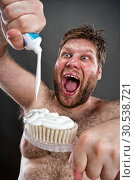Купить «Ugly brushing teeth», фото № 30538721, снято 22 апреля 2012 г. (c) Tryapitsyn Sergiy / Фотобанк Лори