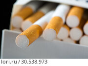 Купить «Cigarettes in pack», фото № 30538973, снято 10 августа 2012 г. (c) Tryapitsyn Sergiy / Фотобанк Лори