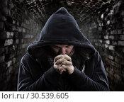 Praying bandit. Стоковое фото, фотограф Tryapitsyn Sergiy / Фотобанк Лори