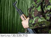 Купить «Soldier holding rifle AK-47», фото № 30539713, снято 11 апреля 2013 г. (c) Tryapitsyn Sergiy / Фотобанк Лори