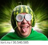 Купить «Funny man with watermelon helmet and googles», фото № 30540585, снято 19 сентября 2013 г. (c) Tryapitsyn Sergiy / Фотобанк Лори