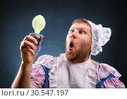 Купить «Man with a pacifier in hand», фото № 30547197, снято 19 ноября 2013 г. (c) Tryapitsyn Sergiy / Фотобанк Лори
