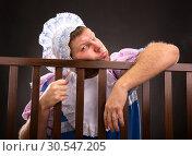 Man in playpen resting. Стоковое фото, фотограф Tryapitsyn Sergiy / Фотобанк Лори