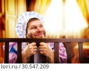 Funny man in playpen looking out. Стоковое фото, фотограф Tryapitsyn Sergiy / Фотобанк Лори
