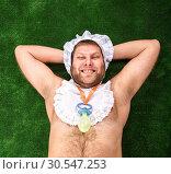 Man weared as baby resting. Стоковое фото, фотограф Tryapitsyn Sergiy / Фотобанк Лори