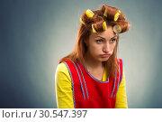 Купить «Sad housewife with curlers on her hair», фото № 30547397, снято 7 декабря 2013 г. (c) Tryapitsyn Sergiy / Фотобанк Лори