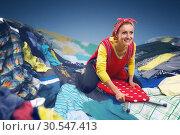 Купить «Happy smiling housewife surfing on ironing-board», фото № 30547413, снято 7 декабря 2013 г. (c) Tryapitsyn Sergiy / Фотобанк Лори