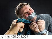 Купить «Man with mouth covered by masking tape», фото № 30548069, снято 21 апреля 2014 г. (c) Tryapitsyn Sergiy / Фотобанк Лори