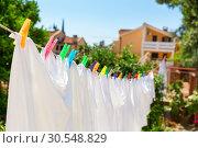 Купить «Cloth with colorful pins», фото № 30548829, снято 10 июня 2014 г. (c) Tryapitsyn Sergiy / Фотобанк Лори