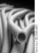 Insulation for pipes closeup. Стоковое фото, фотограф Tryapitsyn Sergiy / Фотобанк Лори