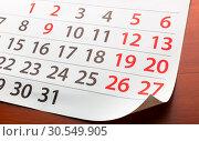 Купить «Page from calendar lies on the table», фото № 30549905, снято 7 ноября 2014 г. (c) Tryapitsyn Sergiy / Фотобанк Лори
