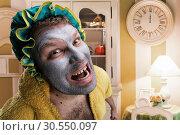 Купить «Strange man with face pack», фото № 30550097, снято 15 октября 2014 г. (c) Tryapitsyn Sergiy / Фотобанк Лори