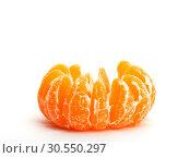 One peeled tangerine. Стоковое фото, фотограф Tryapitsyn Sergiy / Фотобанк Лори