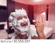 Купить «Ugly womanizer covered with whipped cream», фото № 30550597, снято 17 декабря 2014 г. (c) Tryapitsyn Sergiy / Фотобанк Лори