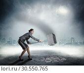 Купить «Businesswoman with sledgehammer», фото № 30550765, снято 25 декабря 2014 г. (c) Tryapitsyn Sergiy / Фотобанк Лори