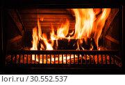 Купить «Firewood burns in the fireplace at night», фото № 30552537, снято 26 января 2019 г. (c) EugeneSergeev / Фотобанк Лори