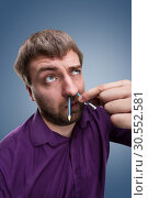 Man with pencil in the nose. Стоковое фото, фотограф Tryapitsyn Sergiy / Фотобанк Лори