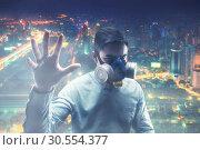 Young man in gas-mask. Стоковое фото, фотограф Tryapitsyn Sergiy / Фотобанк Лори