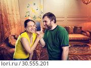 Купить «Young couple listening to music», фото № 30555201, снято 12 июля 2020 г. (c) Tryapitsyn Sergiy / Фотобанк Лори