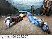 Couple lying on the floor. Стоковое фото, фотограф Tryapitsyn Sergiy / Фотобанк Лори