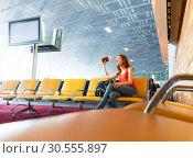 Купить «Young girl waiting for departure.», фото № 30555897, снято 7 июня 2016 г. (c) Tryapitsyn Sergiy / Фотобанк Лори