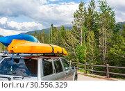 Купить «Boats on top of a car.», фото № 30556329, снято 18 июня 2016 г. (c) Tryapitsyn Sergiy / Фотобанк Лори