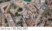 Купить «Urban view from drone of roofs of residential buildings in Spanish city of Huesca», видеоролик № 30562081, снято 24 декабря 2018 г. (c) Яков Филимонов / Фотобанк Лори