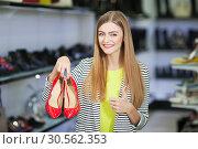 Купить «Happy woman in shoe store», фото № 30562353, снято 9 сентября 2016 г. (c) Tryapitsyn Sergiy / Фотобанк Лори