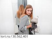 Woman stealing a dress. Стоковое фото, фотограф Tryapitsyn Sergiy / Фотобанк Лори