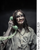Horror zombie girl calling by phone. Стоковое фото, фотограф Tryapitsyn Sergiy / Фотобанк Лори