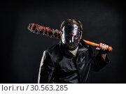 Купить «Bloody maniac in mask and black leather coat», фото № 30563285, снято 7 ноября 2016 г. (c) Tryapitsyn Sergiy / Фотобанк Лори