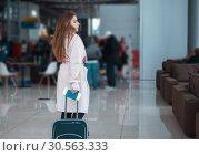 Traveller walking the airport hall. Стоковое фото, фотограф Tryapitsyn Sergiy / Фотобанк Лори
