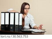 Young female accountant hugs documents folders. Стоковое фото, фотограф Tryapitsyn Sergiy / Фотобанк Лори